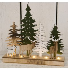 Set with an assortment of coloured natural woods and subtle glittered touches,