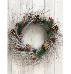 Introduce a rustic woodland inspired charm to any home space or front door with this twig scattered wreath