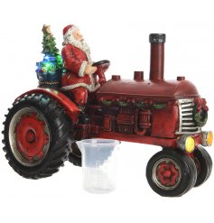 Stand this brightly illuminating LED based Santa on a tractor decoration on any sideboard or windowsill at christmas
