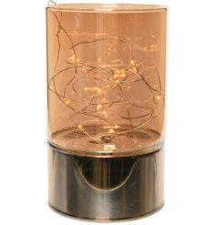A copper glass vase rested on top of a electroplated metal base