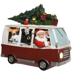 Stand this brightly illuminating LED based Santa in a mini van decoration on any sideboard or windowsill