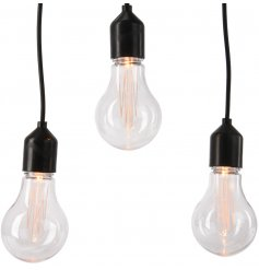 Set with a filament LED inspired look these warm glowing bulbs strung along a chunky black wiring will be sure to bring