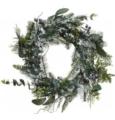 Bring an elegant touch to any Woodland inspired decor with this foliage covered winter frosted wreath