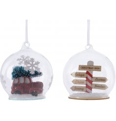 A mix of 2 glass baubles each with a charming and nostalgic Christmas theme displayed inside.