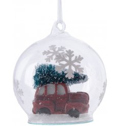 A charming glass bauble, filled with artificial snow and a delightful Christmas scene.