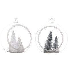 A beautiful assortment of hanging glass dome baubles, filled with a white and green winter tree scene
