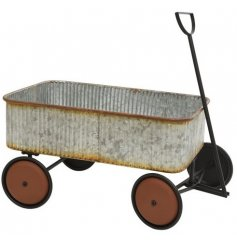 Bring a vintage and distressed edge to any display scene or garden space with this beautifully simple metal cart