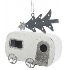 Add a distressed touch to any Winter Wonderland themed tree at Christmas time with this sweet little hanging iron carav