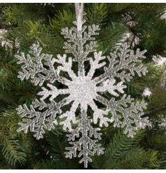 A chic hanging plastic snowflake with an added silver sparkling decal