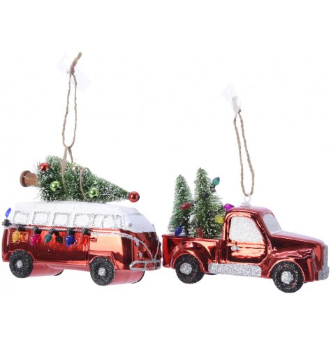 A shiny red camper van and a shiny red truck decorated with a dusting of glitter and colourful miniature fairy lights