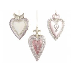 Bring a pretty pink touch to your tree decor this Christmas with this assortment of hanging resin heart decorations