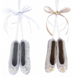 Bring a glittery touch to your tree decor or displays with this sweet assortment of hanging ballerina shoes