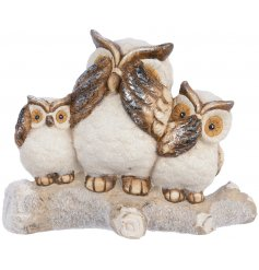 A sweet and sparkly decoration with perched terracotta based owl figures