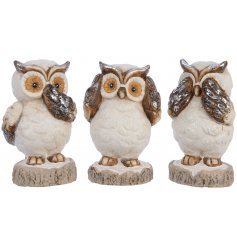 A sweet and sparkly assortment of terracotta based owl figures, set with a rustic edge and an added hint of glitter.