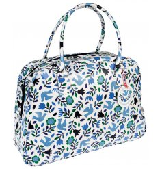 A beautiful pattern of flowers and doves cover this oilcloth travel bag, making it bright and cheery for any weekend aw