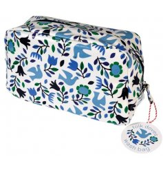 A purple and blue themed washbag, set with a floral dove decal
