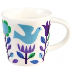 A chic and sweet themed porcelain mug, set with a floral dove decal.