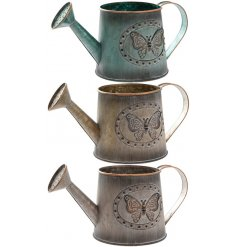 An assortment of 3 Small metal Butterfly Watering Can
