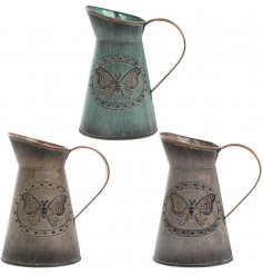 An assortment of 3 Small Metal Butterfly Jugs
