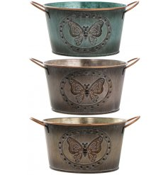 An assortment of 3 Small metal Butterfly Planters