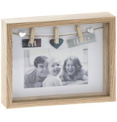 A box peg frame with 'Our Family' design