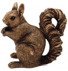 Set in a distressed bronze tone, this beautiful posed squirrel will look perfect in any vintage themed home