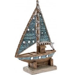 Add a nautical sense to any space of your home interior with this beautifully finished Marine Art Yacht ornament