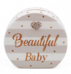 This beautifully decorated money box is a perfect gift idea for a new born baby