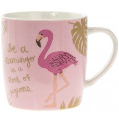 A ceramic mug with Be A Flamingo motto