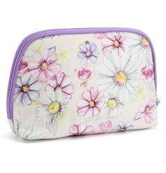 A beautifully illustrated cosmetic bag, detailed with a floral decal and purple trimmings