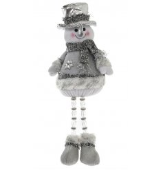 Make a feature with this fantastic silver standing snowman, complete with a sparkling hat and scarf and festive details.
