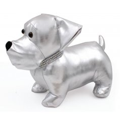 Add a glitzy vibe to your home decor with this snazzy silver fabric dog doorstop