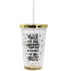 A glam and golden inspired drinking cup with straw and added script quote