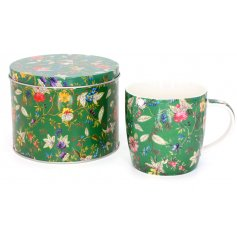 A beautifully detailed china mug, complete with a matching tin box
