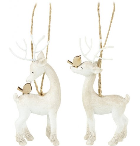 Assorted dreaming reindeer decorations with sweet faces and wooden birds.