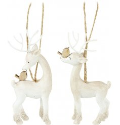 An adorable assortment of sweetly posed hanging resin reindeer, finished in a rustic white tone