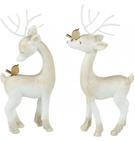 Beautiful dreaming reindeer figures with wooden birds and white metal antlers.