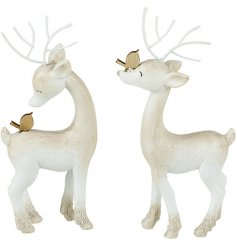 An adorable assortment of sweetly posed standing resin reindeer, finished in a rustic white tone