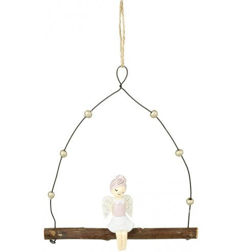 A swing hanger with a dreaming angel figure sat upon a rustic branch.