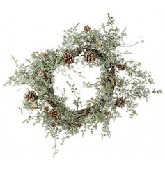 This beautifully finished winter wreath will be sure to invite a cozy festive feel to your home this Christmas