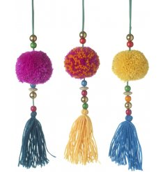 Decorate your tree with an on-trend vibe of colourful arrays of fluffy pom poms