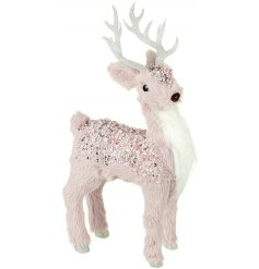 Add a pretty pink touch to your home decor this festive season with this glamorous Reindeer figure