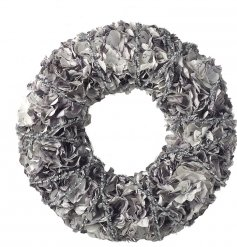 Bring home a chic elegant touch with this beautifully styled round paper wreath with an added silver glittered wrap