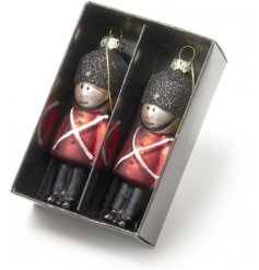 A beautiful set of glittered hanging soldiers set in their traditional red uniform