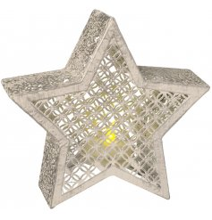 Complete with its LED flickering tlight candle, this free standing star will be sure to add a Rough Luxe to your decor