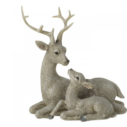 A beautiful gazing reindeer and fawn ornament with a shimmering glitter finish.