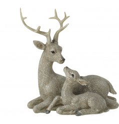 A beautiful ornamental mother and baby deer decoration, coated in a sprinkle of glitter for a winter effect