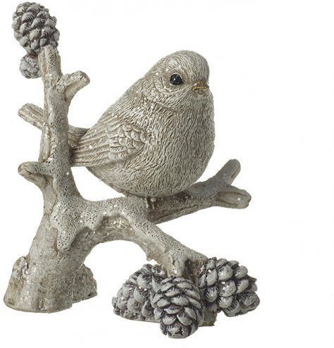 A classic Christmas ornament featuring an elegant bird perched upon a rustic, pinecone branch.