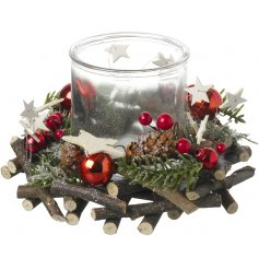 Build up with its layered twigs, berries, pines and stars, this candle holder will look perfect in any themed home