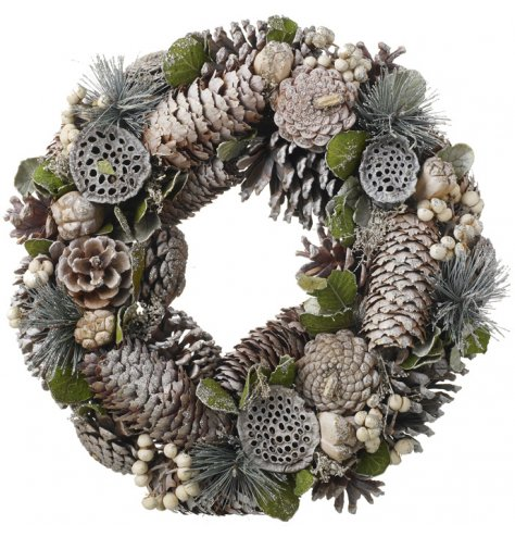 A full Christmas wreath with white berries, pinecones and natural foliage.
